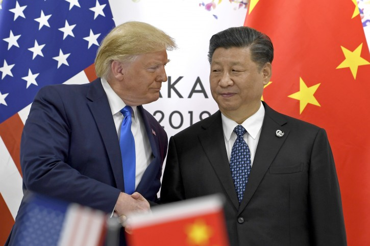 In this June 29, 2019, file photo, U.S. President Donald Trump, left, shakes hands with Chinese President Xi Jinping during a meeting on the sidelines of the G-20 summit in Osaka, western Japan. Facing another U.S. tariff hike, Xi is getting tougher with Washington instead of backing down. Both sides have incentives to settle a trade war that is battering exporters on either side of the Pacific and threatening to tip the global economy into recession. (AP Photo/Susan Walsh, File)