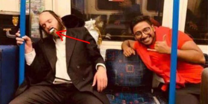 Sleeping Hasidic Man Has 'Palestine' Sticker Placed Over His Mouth On Metro