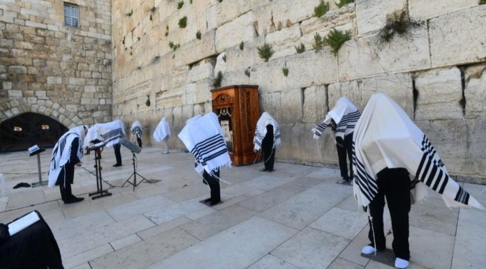 The Priestly Blessing for Passover is recited at the Western Wall by a limited number of kohanim due to the current coronavirus pandemic, on April 12, 2020. (Haim Zach/GPO and The Western Wall Heritage Foundation)