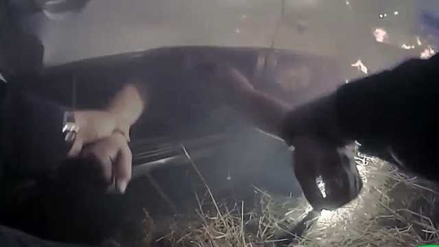 Watch: Police Officer Pulls Woman From Burning Car 1
