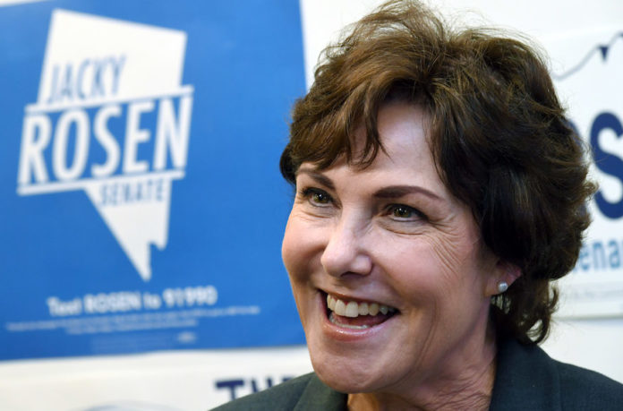 Senate candidate Jacky Rosen is interviewed after rallying supporters at a get-out-the-vote event at a Nevada State Democratic Party field office in Las Vegas, Nov. 4, 2018. (Ethan Miller/Getty Images)